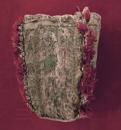 4-panel purse, knitted silk and gold, prob. 13th c., Sens CT; from http://www.kornbluthphoto.com/images/SensPurse103.jpg