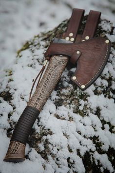 Custom made axe with Baltic and Norse patterns carved in the handle.