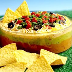 Fiesta Dip - Recipe similar to this one but without the canned diced tomatoes.  Use fresh halved baby tomatoes instead, light sour cream, thinner layer of refried beans (in a shallow dish rather than deep bowl)