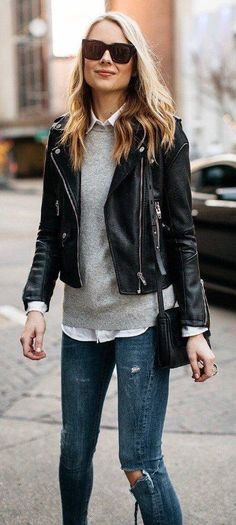 Leather moto over a knit sweater and skinny jeans. See more at www.HerFashionedLife.com