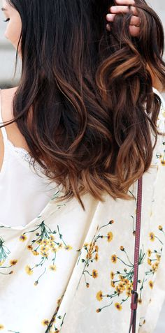 Long brown curly hair with caramel highlights - perfect for Fall!