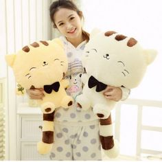Soft, cotton stuffed happy cat that can also be used as a pillow. The cat has a large face and smile, and is 18 inches in height. Features: Stuffed & Plush Item Type: Animals Warning: no Gender: Unise