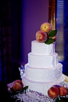 White Wedding Cake with Peaches as Cake Topper