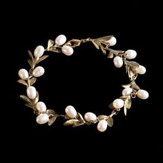 The Boxwood #Bracelet from Michael Michaud features boxwood leaves cast in bronze and accented with white freshwater #pearls.