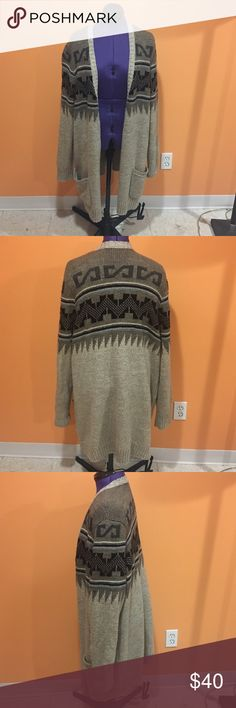 Long tribal cardigan Long heavy weight cardigan. The colors are brown, tan and black. Has pockets in the front. Some very minor pilling in a couple spots, but nothing too noticeable. Other than that in great condition, only worn a couple times. Feel free to make me a reasonable offer☺️. 🚫NO TRADES🚫 American Eagle Outfitters Sweaters Cardigans