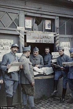 French soldiers buy newspapers in Rexpoede on 6 September...