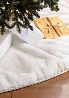 Christmas gifts may never look more glamorous than they do presented on a tree skirt handcrafted of luxuriously soft white faux fur. It's wider than our other tree skirts to accommodate extra presents. The fluffy white fur also adds an extra seasonal element with its soft snow-like appearance.