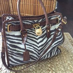 Michael Kors Zebra Print Large Tote Michael Kors zebra print tote with brown leather handles and shoulder strap. Pretty detailing with brass padlock and hardware. Excellent condition. Michael Kors Bags Totes