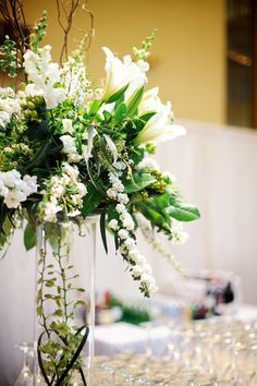White Wedding Book Themed Wedding Reception at Baltimore Library: Angy + Michael Ivory Wedding Flowers, Bridesmaid Flowers, Bridal Flowers, White Flowers, Floral Wedding, Bridesmaids, Wedding Centerpieces, Wedding Decorations, Centrepieces