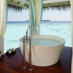 Luxury Bath Tub - Anantara Kihavah Villas in the Maldives This does not look like there would be very much room for your legs...   http://nauticalcottageblog.com