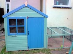 decorated children's playhouse used as a giant rabbit hutch - :D