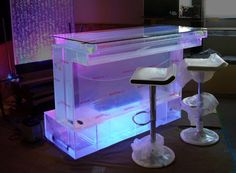 Bar Aquarium. Want something truly unique? You have found it with the Bird's Eye Bar Aquarium! Standard length is 1.5 meters with a capacity of 105 gallons, but custom lengths are available from 1.2 meters, 1.8M, 5M, 6M, 7M, and even a whopping 10 meters long! All surfaces are made from high quality acrylic, except the top, which is made of high strength and scratch resistant tempered glass.
