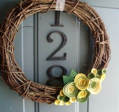 For my front door...but with rich green leaves, purple, teal, and orange/brown felt flowers??