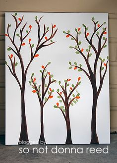 painted trees on a canvas with fingerprint leaves.