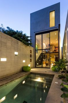 """Raw House is a single-family home designed by Taller Estilo Arquitectura in Merida, Mexico. Our concern for the """"Raw House"""" project was . Architecture Design, Futuristic Architecture, Narrow House, Unique House Design, Luxury Pools, Minimalist Home, Exterior Design, House Styles, Glass Doors"""