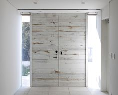 lightly painted timber doors. edward suzuki architecture: villa by the sea