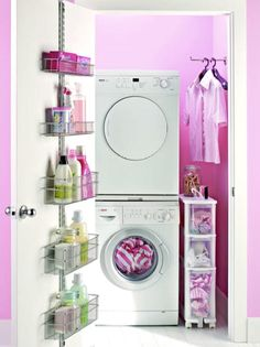 Love this use of closet space for the stacked washer and dryer - love the pink paint, too...