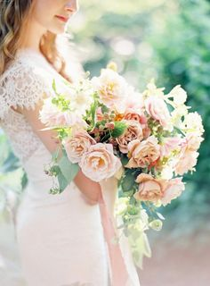 Romantic Peach Bouquet with a Lace Wedding Dress | Kayla Barker Fine Art Photography | http://heyweddinglady.com/southern-peach-summer-wedding-palette
