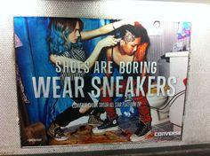 Pub Converse dans le métro parisien : Shoes are boring wear sneakers.