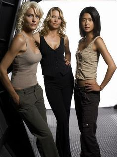 Number Six, Numer Three (D'Anna Biers) & Lt Sharon 'Boomer' Valerii - Tricia Helfer, Lucy Lawless & Grace Park in Battlestar Galactica. Grace Park, Tricia Helfer, Kampfstern Galactica, Battlestar Galactica, Lucy Lawless, Science Fiction, Katee Sackhoff, Sci Fi Shows, Sci Fi Tv