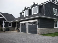 Like the dark siding, would change roof a bit to stand out more. Maybe different garage doors.