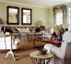 Anna Wintour's Home...mirror trim is startling wonderful...love the incredible furniture mix. maryanne