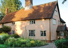 Camomile Cottage | United kingdom Suffolk England. A Suffolk pink hideaway where you can stay all day. Relaxed owners, tea and homemade cake on arrival, a log fire to read by... delicious!