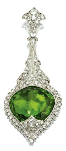 PERIDOT AND DIAMOND PENDANT The drilled briolette peridot measuring approximately 20.0 by 22.0 by 11.0 mm., in a frame of conforming shape with pierced surmount, set with numerous single-cut and old European-cut diamonds weighing approximately 2.25 carats, mounted in platinum, signed BBB, possibly for Bailey, Banks & Biddle, numbered 95494.