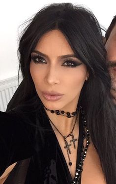 Dark makeup, black choker and necklace layering