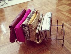 Pot lid rack - Slide skinny purses and wallets into this standing rack to keep closet shelves tidy without even trying.