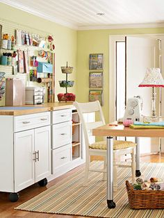 pretty sewing room- Ooooh! Maybe that's what I need! A kitchen island to use for storage and then I could turn the top into an ironing board!!