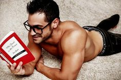 Perfection: A shirtless hot guy with glasses and a bit of facial hair reading. What more could a girl want?