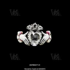 Ring with a crowned heart held by two hands. England, 1706