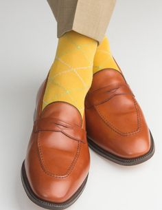 These luxury men's yellow raker dress socks are made with an exceptionally soft mercerized cotton. Expertly knitted at a third-generation North Carolina mill, these fashionable socks are a timeless addition to every well-dressed man's wardrobe. Made In USA200 Needle CountOver-The-Calf FitLinked Toe 67% Mercerized Cotton32% Nylon1% Spandex Fits Sizes 8 - 12