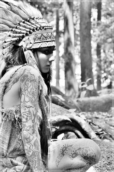 indian girl with headdress in the woods