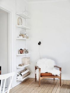 Living room nook with a white sheepskin draped over a leather armchair