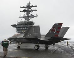 An F-35C Lightning II carrier variant Joint Strike Fighter from the Pax River Integrated Test Force conducts its first arrested landing aboard the aircraft carrier USS Dwight D. Eisenhower (CVN 69).