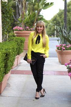 bow yellow blouse + black trousers + studded heels  via Champagne Lifestyle on a Beer Budget