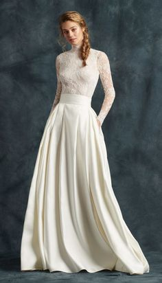 Chic two piece lace long-sleeve wedding dress with flattering details; Featured Dress: Atelier Emé