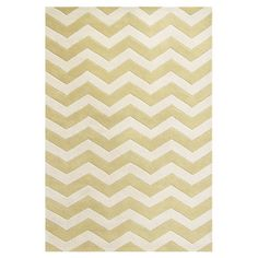 Hand-tufted in ivory and gold tones, this rug showcases a chevron motif. The ideal way to refresh your living room or study scheme. P...