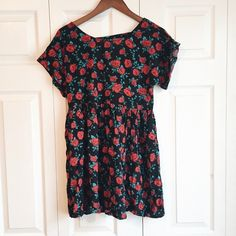 Floral Babydoll dress Totally rad black baby doll dress with vibrant all over floral print. Features an open back and loose fit. Price is very firm. Dresses Mini