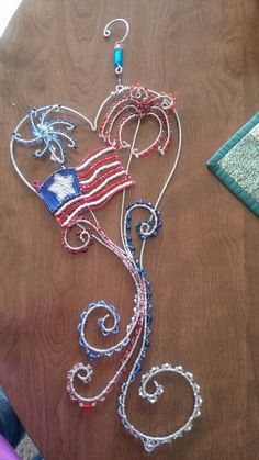 Wire wrapped beaded sun catcher with beads,  flag fireworks.