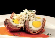 NOSE DIVE's Scotch Egg:  A pub classic, House Made Sausage, Panko, Sweet Pepper Relish, Buttermilk Dressing