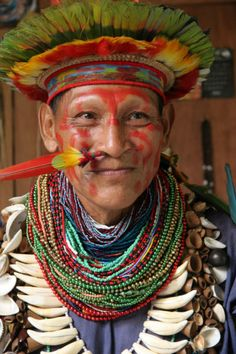 A shaman man (Alberto Grefa, Cofan) from the Ecuadorian Amazon Rainforest, wearing traditional dress.
