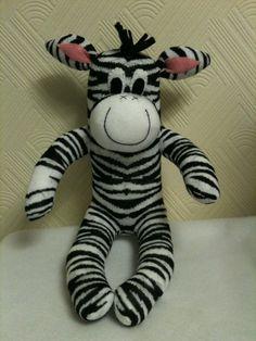 This zebra has been created using a pair of zebra stripe socks and felt. MEMBER - SockMonkeyEmporiumUK