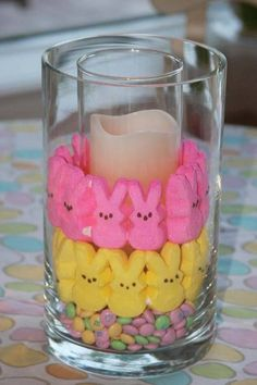 Easter Peeps decoration - Arrange a small cylinder glass (for the candle) inside a larger one. Layer different candies to create this Easter treat. After Easter replace the candies with different botanicals, marbles and other decorative filler. Easter Table, Easter Party, Easter Dinner, Easter Decor, Easter Centerpiece, Spring Crafts, Holiday Crafts, Holiday Fun, Festive