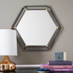 Rustic Metal Mirrors - Hexagon | west elm. We could do 3 or 4 of these clustered on the wall.