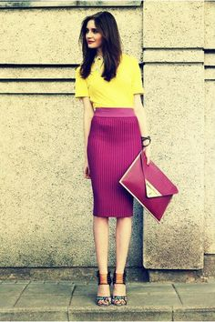 Yellow shirt, magenta pencil skirt, and turquoise and orange heels.