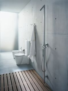 Philippe Starck - open shower, wood floors, exposed walls