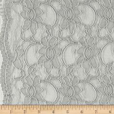 Supreme Lace Grey from @fabricdotcom  Delicate and classic, this sheer lace has finished scalloped edges on both sides, and a 25% mechanical stretch across the grain for comfort and ease. This lace fabric appropriate for lingerie, overlays on skirts or dresses, feminine apparel accents, and wraps or shrugs.